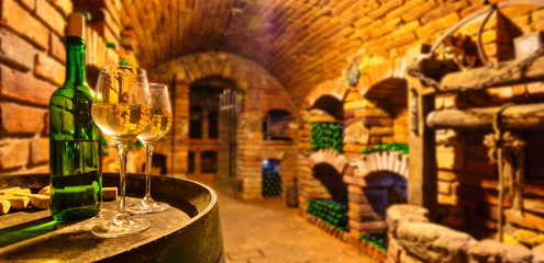 Small wine cellar with bottle and glasses of wine
