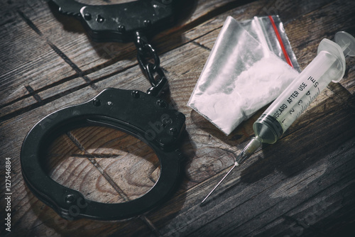 Fotografija  handcuffs and narcotic