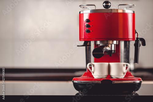 Fototapeta An espresso machine and two cups