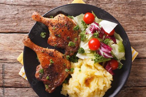 Tablou Canvas roasted duck leg with mashed potatoes side dishes and fresh salad closeup