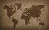 Brown world map on old vintage flax linen canvas - 127577405