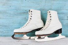 Vintage Ice Skates For Figure Skating On Turquoise Background