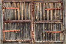 Old Wooden Door With Rusty Hinges