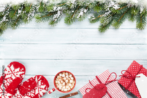 Spoed Foto op Canvas Chocolade Christmas background with fir tree, gifts, hot chocolate
