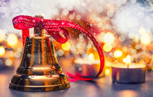 Christmas. Christmas Bell With Red Ribbon Candles And Snowy Background. Happy Christmas Text.