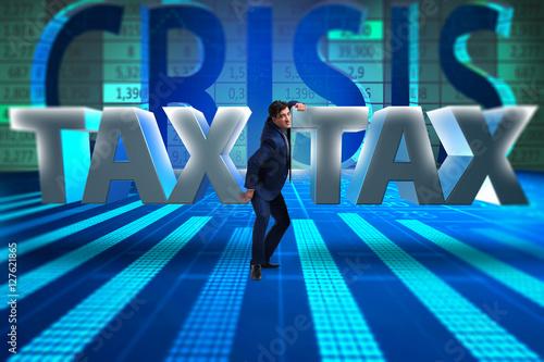 Businessman in high taxes concept Canvas Print