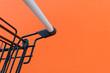 Leinwanddruck Bild - Minimalism style, Shopping cart and orange wall.