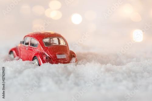 Fotografie, Obraz  Little red car toy stuck in snow.
