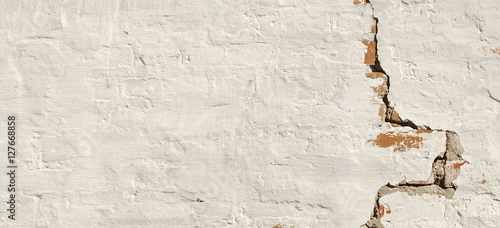Poster Graffiti Cracked Red Brick Wall With Shabby White Plaster Background Tex