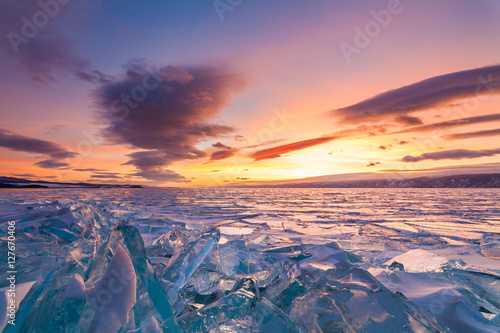 Poster Corail Colorful sunset over the crystal ice of Baikal lake