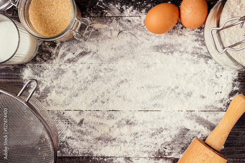 Photo  Baking background. Baking ingredients on the wooden table