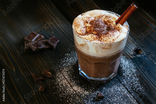 Spoed Foto op Canvas Chocolade hot chocolate with whipped cream on the black table