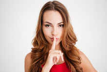 Happy Attractive Young Woman Showing Silence Sign
