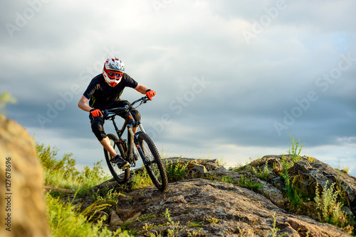 Staande foto Fiets Professional Cyclist Riding the Bike on the Rocky Trail. Extreme Sport.