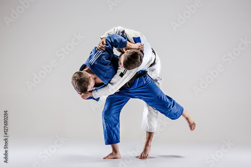 Photo  The two judokas fighters fighting men