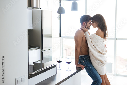 Sexy couple standing and hugging on the kitchen Fototapeta