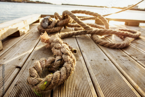 wooden pier rope, moored fishing boat