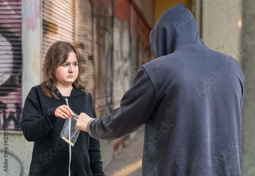 Photo  Young addicted woman is buying drugs from drug dealer.