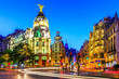 Madrid, Spain. Gran Via, main shopping street at dusk.