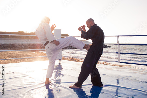Photo  training of  karate fighters in the morning