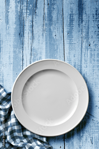 white dish on aged blue table Canvas Print