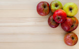 colorful organic apples on a wooden background