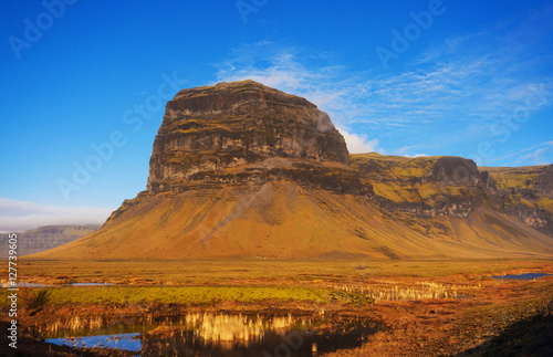 фотография  Lomagnupur Mountain, a precipitous promontory on the south coast of Iceland