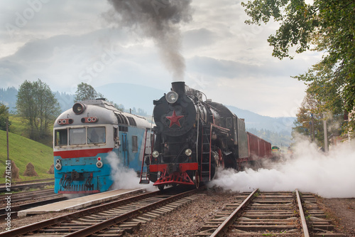 Garden Poster Bestsellers Retro locomotive and electric locomotive at the station