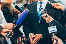 Journalists Interviewing Businessman.