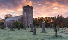 Saint Oswald's Church In The Village Of Ravenstonedale, Cumbria, England Near The Yorkshire Dales On A Frosty Sunrise Morning. Finished In 1744 The Site Contains Ruins Of A 13/14th Century Cloister.