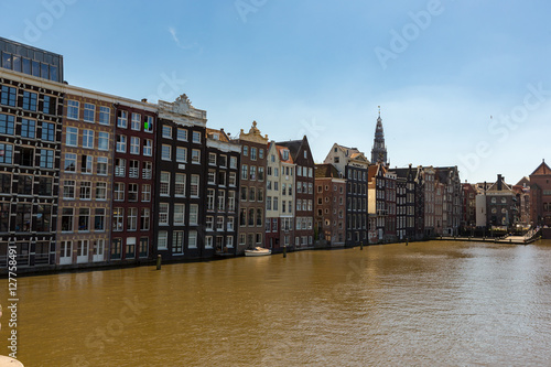 Photo  Canalhouses on the Damrak in Amsterdam Holland