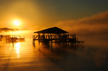 Boat House Silhouetted By Sunshine