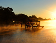 Boat House Surrounded By Golden Fog
