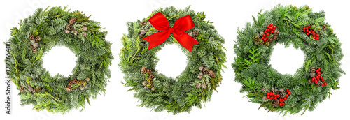 Photo  Christmas wreath pine spruce twigs cones berries ribbon bow
