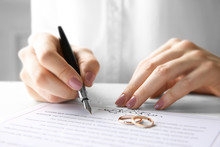 Woman Signing Marriage Contrac...