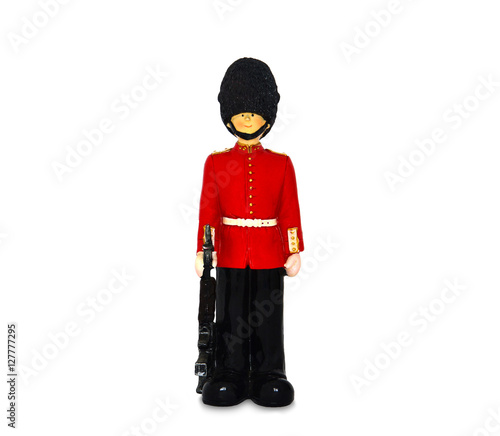 Photo  Queen's guard statue in traditional uniform with weapon, British soldier, isolat