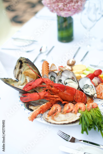Recess Fitting Seafoods Seafood Lobster dinner on table