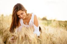 Beautiful Woman In Wheat Meadow