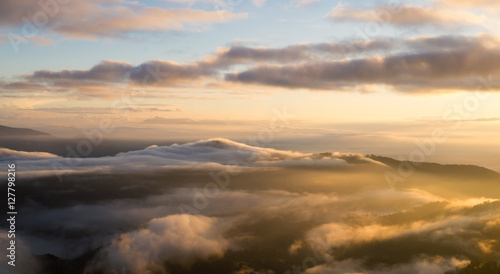 Foto auf Gartenposter Hugel Landscape of sunrise and moving mist in the mountain and hill. View sunrise point of mountain at Doi-Montngo, Chiang Mai –Thailand