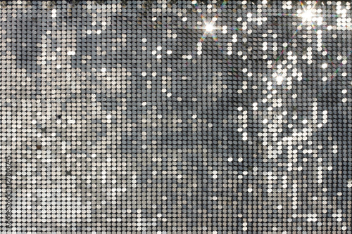 Fotografía  Silver background mosaic with light spots and stars