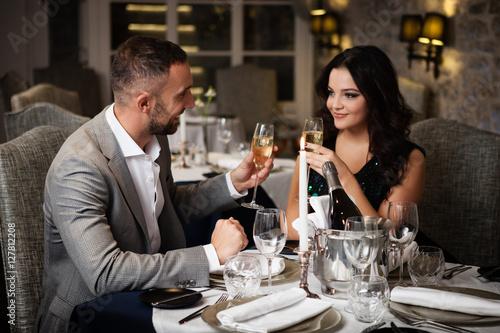 Fotobehang Restaurant Couple celebrating in restaurant