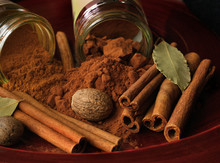 Cinnamon, Ground And In Stick Is Shown With Nutmeg And Bay Leaves In This Photo Of Holiday Spices