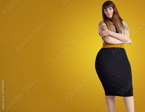 plus size model wears dress showing her curvy body Fototapeta