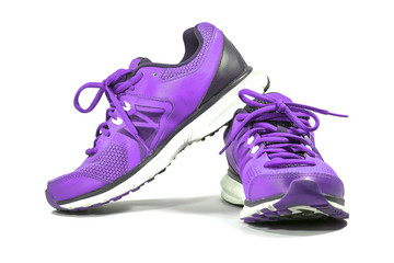 Colorful purple running and fashion sneaker shoes isolated on white background.