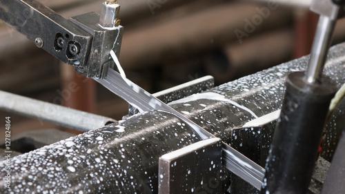 Fotografie, Obraz  Bandsaw cutting a steel pipe