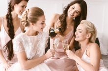 Amused Bride And Bridesmaids H...