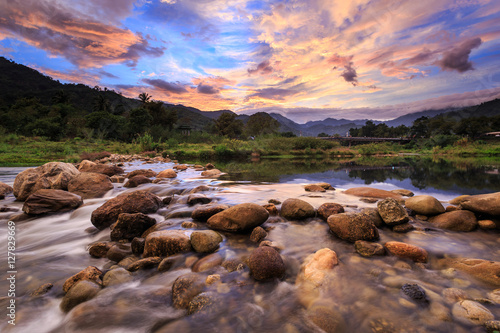 Foto auf AluDibond Cappuccino Small river and beautiful sunset in Kiriwong village. The best O