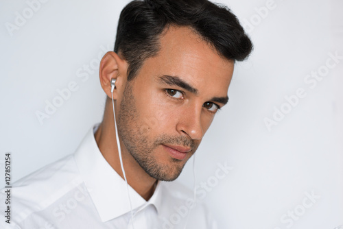 Close-up portrait of handsome caucasian young man enjoying his