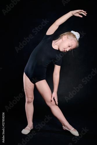 5b564dbe3 Beautiful sport training girl portrait in leotard in nhe black room ...