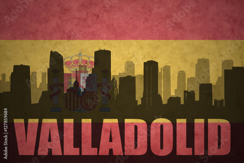 abstract silhouette of the city with text Valladolid at the vintage spanish flag